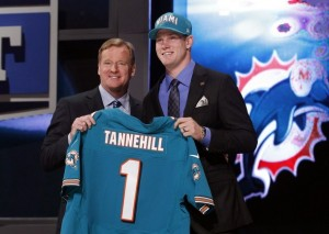 Ryan Tannehill from Texas A&M Uni stands with NFL Commissioner Roger Goodell after being selected by the Miami Dolphins as the eighth overall pick in the 2012 NFL Draft in New York