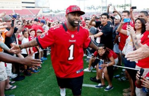 Darrelle Revis greets fans at the Bucs 2013 NFL Draft Party. Photo courtesy of the Buccaneers