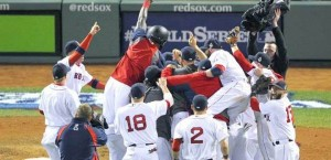 Red Sox win the first World Series clinched in Boston since 1918.