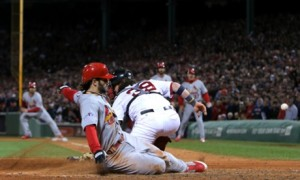 The Cards even the World Series at one game each. Boston helped with some key errors in the 4-2 St. Lpios win. .
