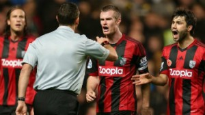 The West Brom players were furious with the referee's decision to award Chelsea a late penalty.