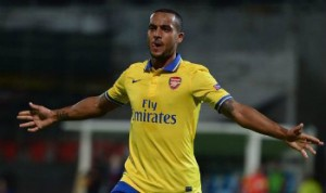 Theo Walcott scored twice to help Arsenal back to the top of the table.