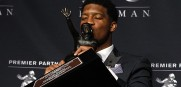 Winston kisses the Heisman Trophy and his draft stock keeps getting higher.