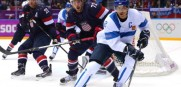 Teemu Selanne #8 of Finland handles the puck against Justin Faulk #72 of the United States in the second period during the Men's Ice Hockey Bronze Medal Game on Day 15 of the 2014 Sochi Winter Olympics at Bolshoy Ice Dome