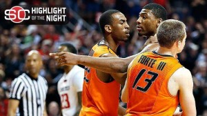 Oklahoma State forward Marcus Smart is being held back by his teammates after pushing a fan at Texas Tech.