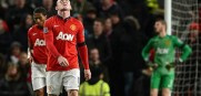 Wayne Rooney of Manchester United reacts after Fulham's second goal that came in injury time giving Fulham a draw.