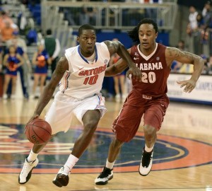 Florida's Dorian Finney-Smith drives around Alabama's Levi Randolph.