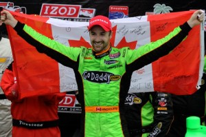 Andretti Autosports driver James Hinchcliffe displays Canada's flag as he celebrates his first win as an IndyCar driver at the Honda Grand Prix of St Petersburg.