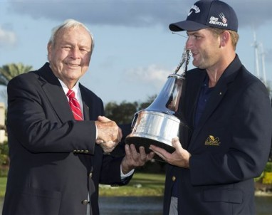 Arnold Palmer presents the trophy to Matt Every, right, after Every won the Arnold Palmer Invitational yesterday in Orlando