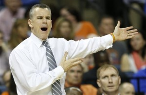 Florida head coach Billy Donovan, speaks to his players against UCLA during the first half in a regional semifinal game at the NCAA college basketball tournament, Thursday, March 27, 2014, in Memphis, Tenn.