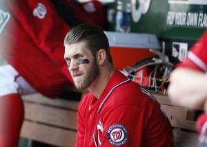 Washington Nationals' Bryce Harper sits on the bench adfter being pulled from the game for not hustling