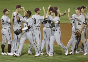 Charleston players trade high fives as the celebrate after defeating Florida 3-2. The Gators face UNC in a win or go home game today at 1pm