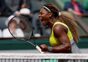 Defending French Open Champion Serena Williams of the U.S celebrates her victory against Alize Lim of France, during their women's singles match today in Paris