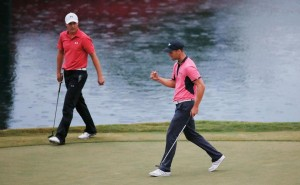 Martin Kaymer was pumped after making a long par putt on No. 17 that allowed him to hold off Jim Furyk and Jordan Spieth (left). To win the Players Championship in Jacksonville.
