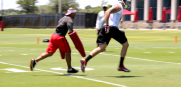 Bucs wide receiver Mike Evans runs through a drill with coach Andrew Hayes-Stoker