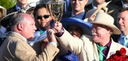 Owners Perry Martin (left) and Steve Coburn [in the hat] celebrate California Chromes win at the Kentucky Derby for Dumb Ass Partners.