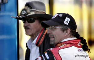 Racing legend Richard Petty, left, talks with his son NASCAR driver Kyle Petty. Just one of many father and son teams in NASCAR.