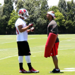 Robert Herron talks to wide receivers coach Andrew Hayes-Stocker
