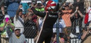 Spiderman, aka,  Helio-Castroneves climbs the fence in Detroit after winning Sunday's second half of the Duel in Detroit.
