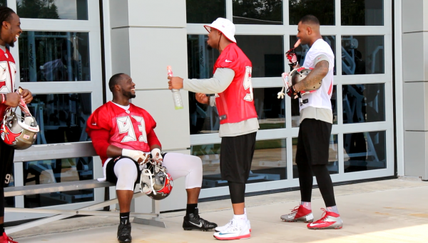 Louis Murphy and Jonathan Casillas share a laugh with Gerald McCoy while enjoying some frozen treats