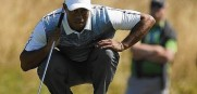 Tiger Woods of the U.S. up his putt during the first round of the British Open Championship at the Royal Liverpool Golf Club in Hoylake