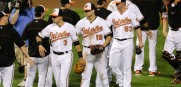 Baltimore Orioles' Ryan Flaherty, Chris Davis and Zach Britton, from left, high-five teammates after beating the Rays last night