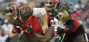Bucs quarterback Josh McCown sacked by Chris Clemons