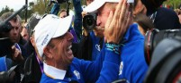 Jamie Donaldson celebrates with Europe's winning Ryder Cup captain Paul McGinley