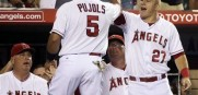 Los Angeles Angels' Albert Pujols (5) high-fives teammate Mike Trout as they hope to hold on to the AL West