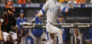 Kansas City Royals' Alex Gordon (4) watches his solo home run during the 10th inning of Game 1 of the American League baseball championship series against the Baltimore Orioles.