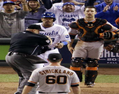 Kansas City Royals' Salvador Perez (13) and San Francisco Giants' Hunter Strickland (60) exchange words during the sixth inning of Game 2 of the World Series