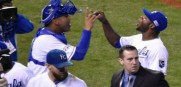 Kansas City Royals catcher Salvador Perez and Lorenzo Cain celebrate after beating Baltimore Orioles 2-1 to give them a comanding 3-0 lead in the ALCS