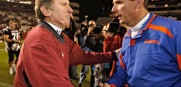 Steve Spurrier left congratulates friend and Florida coach Urban Meyer