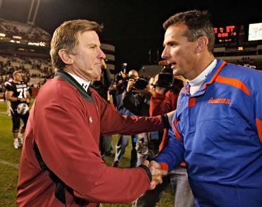 Steve Spurrier left congratulates friend and Florida coach Urban Meyer