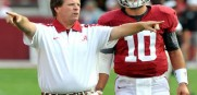 Former Alabama offensive coordinator Jim McElwain instructs quarterback AJ McCarron in practice