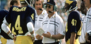 Michigan QB Jim Harbaugh #4 listening to Bo Schembechler in Ann Arbor where he will now be the coach.