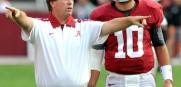 Former Alabama offensive coordinator Jim McElwain instructs quarterback AJ McCarron in practice. He was 48-6 before leaving to coach CSU