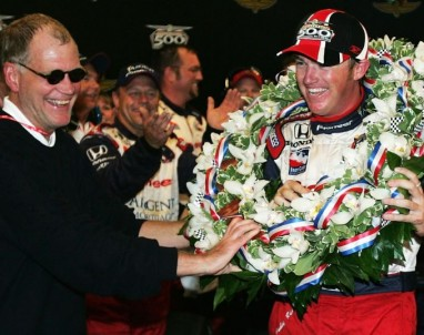 Car owner David Letterman puts the wreath around the neck of Budddy Rice in a makeshift victory lane after winning the rain-shortened 88th running of the Indianapolis 500 on May 30, 2004.